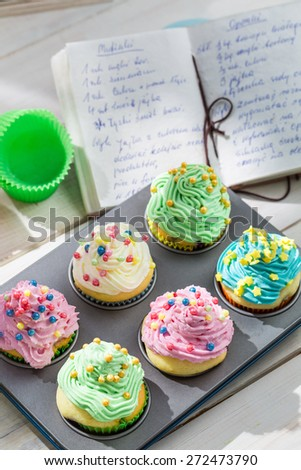 Preparation for sweet muffins with sweet cream - stock photo