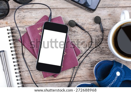 Preparation for travel,outfit, tablet ,passport, camera on wooden table - stock photo