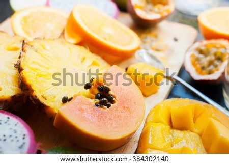 Preparation Fresh Juice Yellow Orange Tropical Fruits Papaya Pine Apple Mango Passion Fruit Dragon Orange  - stock photo