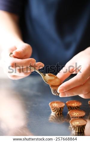 Preparation handmade chocolate candies, close up - stock photo