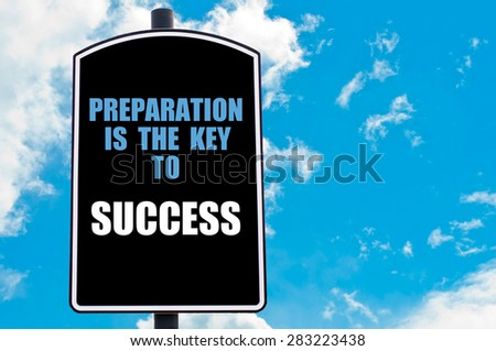 PREPARATION IS THE KEY TO SUCCESS motivational quote written on road sign isolated over clear blue sky background with available copy space. Concept  image - stock photo