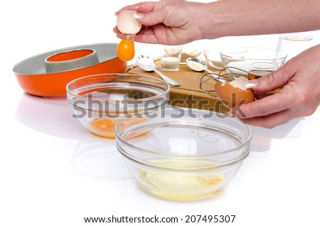 Preparation of a French ring cake, named savarin, isolated on white