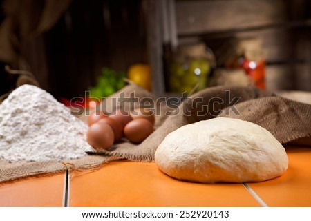 Preparation of bread in the kitchen. Kneading