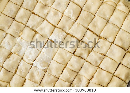 Preparation of dough for Baklava, the traditional Turkish dessert - stock photo