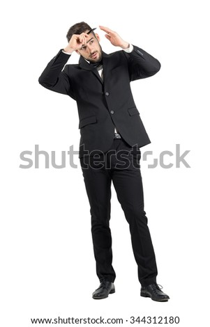 Preparation of elegant young groom combing his hair. Full body length portrait isolated over white studio background. - stock photo
