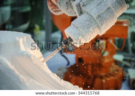 Preparation of foam plastic for installation on walls of buildings - stock photo