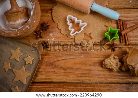 Preparation of gingerbread festive cookies - stock photo