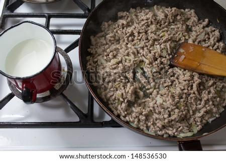 Preparation of lasagne, Italian cuisine in Polish conditions. - stock photo