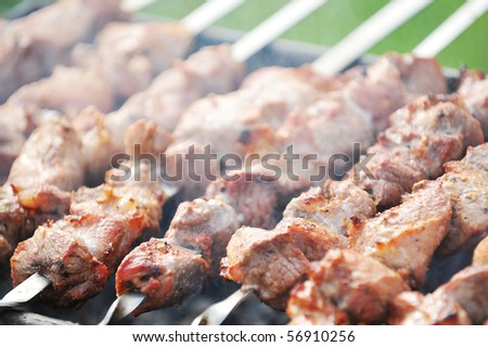 Preparation of meat slices in sauce on fire - stock photo
