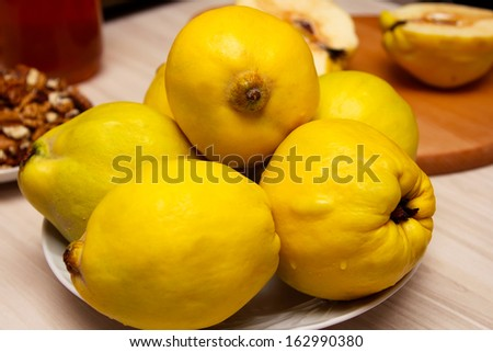 Preparation of quince with honey and nuts - stock photo