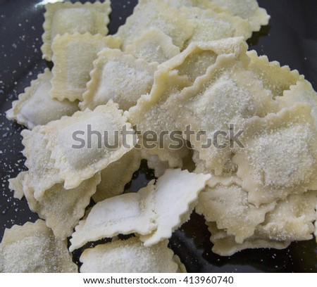 preparation of ravioli pasta with sage butter sauce , italian food