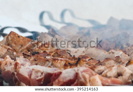 Preparation of shashlik (meat on the coals) in brazier.