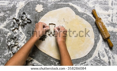 Preparation of the dough . Making cookies from fresh dough . On the stone table with flour.  Top view - stock photo