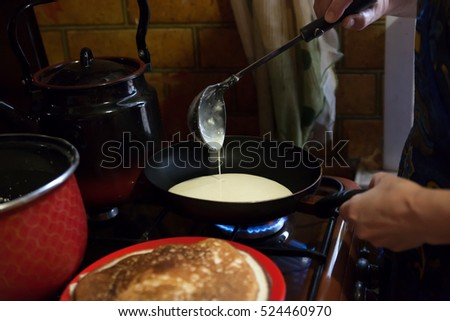 Preparation of traditional Russian  pancakes on Shrove Tuesday.