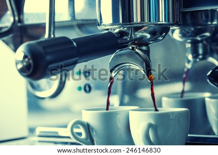 Preparation of two espresso in coffee machines.Professional coffee machine making espresso in a Two cafe. - stock photo