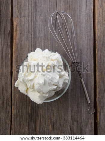 Preparation of whipped cream with a hand mixer metal on a wooden background. Top view. Mascarpone. - stock photo