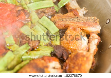 Preparation step of authentic Paella Valenciana Chicken, rabbit and vegetables