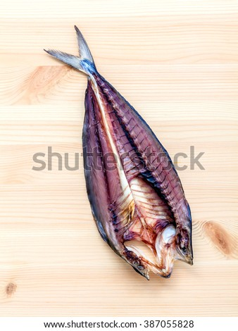 Prepare cooking traditional asian food preserved salted fish on wooden cutting board. - stock photo