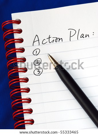 Prepare the action plan in a writing pad isolated on blue