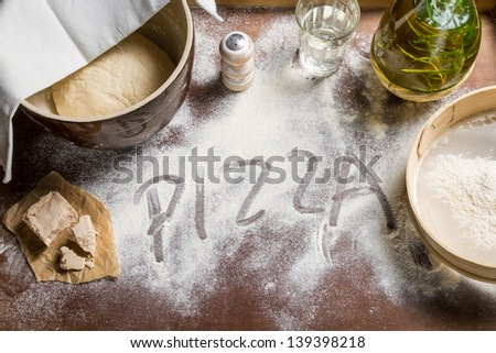 Prepare yeast dough for pizza - stock photo