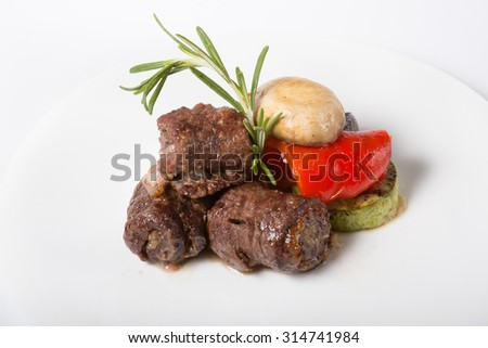 Prepared beef or lamb meat in kebab style with grilled vegetables - stock photo