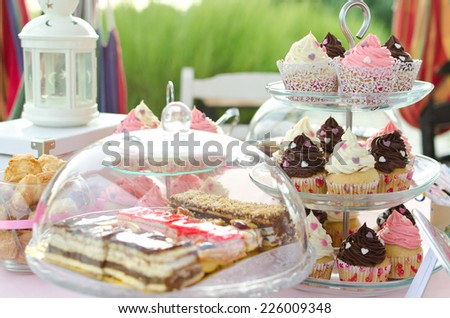 Prepared birthday table in summer on the beach. 30 Birthday party buffet - stock photo
