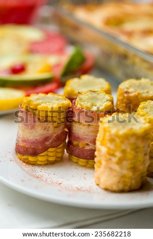 prepared corn pieces with bacon and cheese. Vertical image. - stock photo