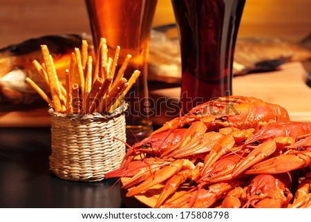 Prepared crawfish, snacks and glasses of beer, close up - stock photo