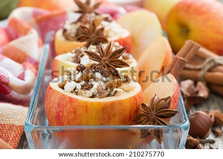 prepared for baking stuffed apples in a glass form, close-up, selective focus, horizontal - stock photo