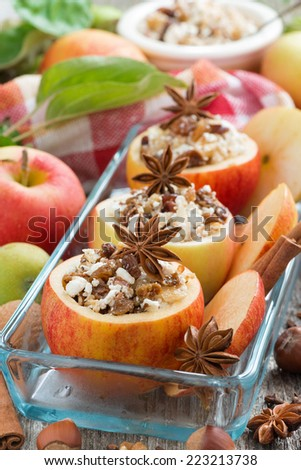 prepared for baking stuffed apples in a glass form, top view, vertical - stock photo