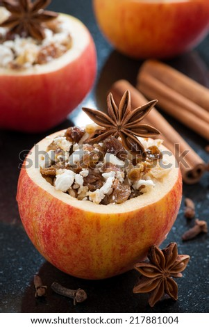 prepared for baking stuffed apples on a black background, vertical, close-up - stock photo