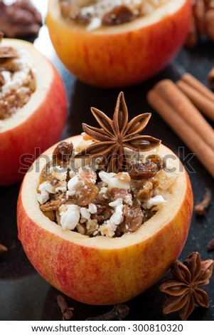 prepared for baking stuffed apples on a black background, vertical, top view, close-up - stock photo