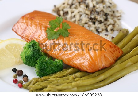 Prepared salmon fish on a plate served with vegetables - stock photo