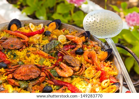 Prepared Spanish Paella with Crabs and Shrimps - stock photo