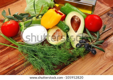 prepared vegetables on wood with sour cream - stock photo