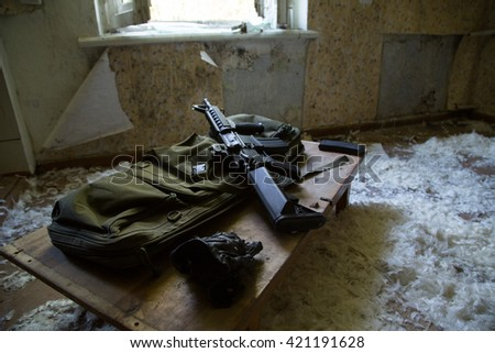 prepared weapons, abandoned house ruined house, abandoned building, mess, ruined interior - stock photo