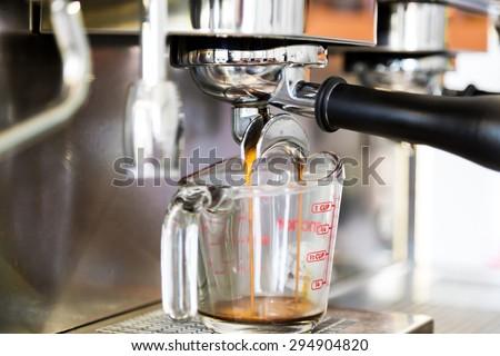 Prepares espresso in coffee shop - stock photo