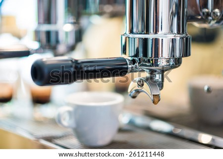 Prepares espresso in modern coffee shop, Coffee machine - stock photo
