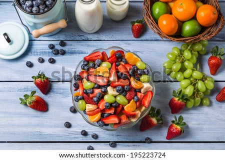 Preparing a healthy spring fruit salad - stock photo