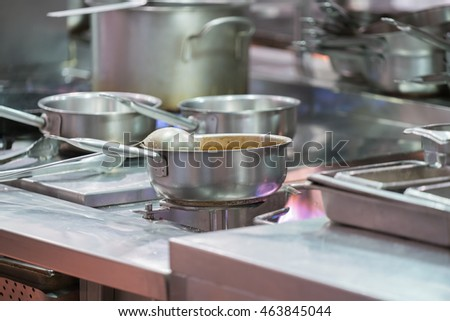 Preparing a lot of food. saucepans in Restaurant kitchen.