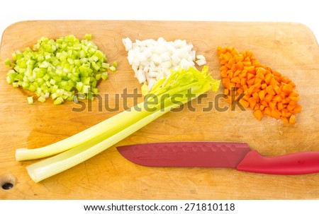 Preparing a mixture of carrots, celery and onions as mirepoix for a pot of Great Northern Beans and Ham Soup. - stock photo