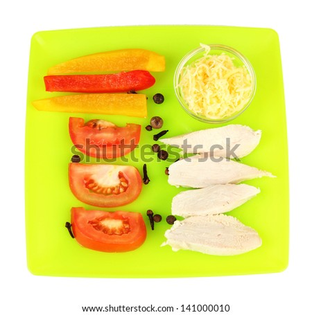 Preparing chicken stir fry with vegetables and spices on color plate, isolated on white