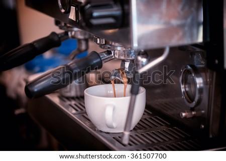 preparing coffee in cafe - stock photo