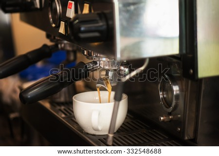 preparing coffee in coffee shop with professional coffee machine - stock photo
