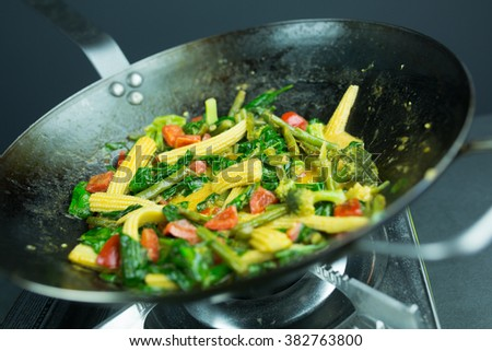 preparing curry vegetables - stock photo