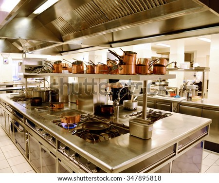 Preparing Dinner In Restaurant Kitchen