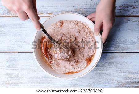 Preparing dough, mixing ingredients - stock photo