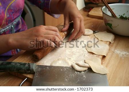 preparing dumplings - stock photo