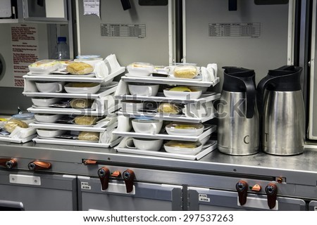 Preparing food for the passengers in the kitchen air plane. Lunch for airline passengers. Dinner menu at airplane. Meals for Aircraft on kitchen.