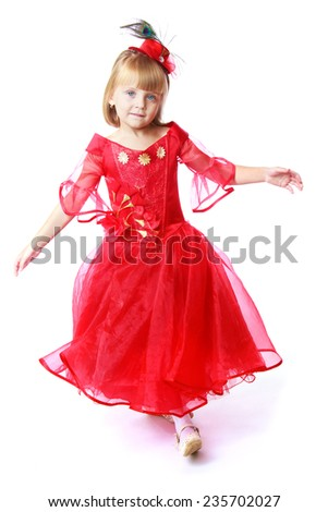 Preparing for Christmas, holiday, baby joy concept .Charming little girl in a bright red dress.Isolated on white background.